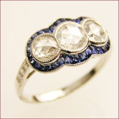 I think I need this! no but seriously - maybe with two sapphires instead of the sapphires around the edge.