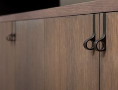 Quirky one finger door handle for kitchen cabinets.