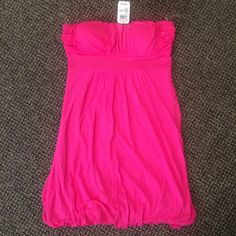 Pink Strapless Dress Pink strapless, flowy dress with elastic at the bottom. NWT, American Dream brand purchased from Delia's. Super cute and would go great paired with sandals and a jean jacket  Delia's Dresses Strapless