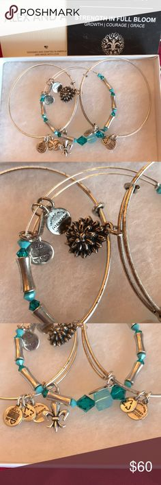 Alex And Ani Strength in Full Bloom - 3 Bangles The Strength in Full Bloom set of three is a graceful yet powerful combination of symbols and vibrant color. The protective Fleur de lie Is a celebration of life. The water Lily is a symbol of beauty through turmoil as it rises above the water to the light. Bright teal correlates with the throat chakra, encouraging the voice's power to ignite the hearts of others. Embrace the resilient energy of this set to adorn your soul with strength and…