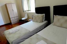 Eden Cosy Home large Twin Bedroom Batu Ferringh with twin bed, balcony overlooking the garden and private bathroom combine to offer visitors that perfect, calm getaway. Batu Ferringhi, Twin Room, Shared Bathroom, Digital Nomad, Large Windows, Cosy, Twins, Bedroom, Furniture