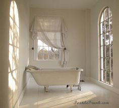 Antique Textile collector's home - love this bathroom & the window treatment!