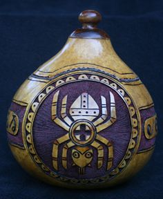 Carved gourd container. Gourd, Curly Maple, mother of Pearl inlay.