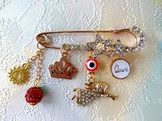 Baby pin, stroller pin. Brooch pin jewelry, Safety pin newborn, evil eye jewelry, love pin, baby shower gift, gold pin jewelry, custom pin by AdornmentTala on Etsy Baby Jewelry, Charm Jewelry, Jewelry Art, Handmade Jewelry, Vintage Jewelry, Jewellery, Safety Pin Crafts, Safety Pin Jewelry, Small Gift Boxes