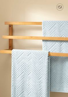Add this sleek bamboo towel rack to your powder room or bathroom when updating or remodeling your home.This eco-friendly addition looks polished and is easy to install.