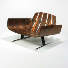 JORGE ZALSZUPIN    lounge chair    L'Atelier  Brazil, c. 1970  rosewood, chrome-plated and enameled steel, brass  38 w x 30 d x 23.5 h inches