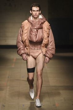 See the complete MAN Fall 2017 Menswear collection. He looks like he's wrapped with his innards...ewww