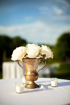 Equestrian style centerpiece: roses in trophies