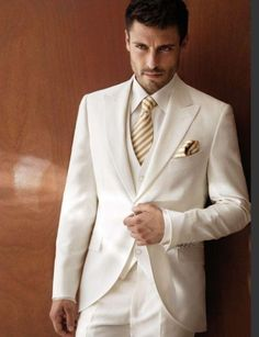 2015 White ivory Wedding Suits for Men Tuxedos Peaked Lapel Groomsmen Suits 3 Pieces Mens Suits Slim Fit Planning your Make it easy and rent a tux from Downtown Tux and Gown. White Wedding Suits For Men, Mens White Suit, Men's Tuxedo Wedding, Ivory Wedding, Mens Suits, Wedding Groom, Wedding Bells, Groom Tuxedo, Tuxedo For Men
