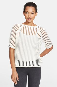 Layer an openwork sweater over a cool top for a chic ensemble.