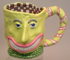 Face mugs by Judie Bomberoger