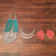 Bundle of 3 Necklaces 1 turquoise and silver, 1 silver with tribal design and crystals and 1 coral and bronze/gold. Center necklace is from Claire's. Claire's Jewelry Necklaces