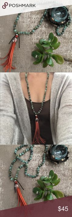 """Mala Crystal Stone Leather Tassel Necklace Turquoise color stone beaded necklace. Gorgeous orange thick and rich leather tassel with a crystal bead and orange bead accent. Leaf motif copper tone bead. Oversized and stunning. Handmade and purchased at a craft market. One of those """"museum pieces"""" (thank you @momoretro Megan for the term) that I️ adore and stare at but rarely reach for. Real stone beads but don't remember the name/type. If you happen to know Pls tag me! Would love to know…"""