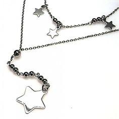 Gargantilla de plata de primera ley con estrellas lisas combinadas colgando