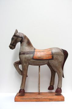 Painted timber horse on stand