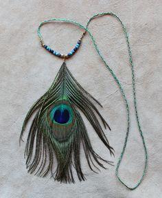 Peacock feather necklace by Lupa. At http://thegreenwolf.etsy.com