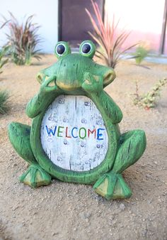 A whimsical frog welcomes you into the garden with his sly smile. Solar-Powered marquee lights automatically turn on at dusk.
