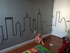 The finished product! Didn't take long at all!  My modern baby/toddler bedroom! Washi tape skyline. City themed bedroom. Modern boys bedroom.  DIY boys bedroom. NYC bedroom. Architectural kids bedroom. Cityscape bedroom.