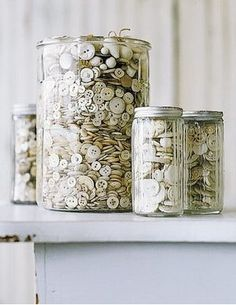 Jars of buttons.  If you don't have enough buttons to fill a large jar, make a cylindrical shape in cardboard and fill with anything (styrofoam, fabric scraps, bubble wrap) to keep its round shape.  Add buttons around the cardboard, giving the appearance of a full jar.