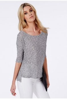 Throw this lush lightweight grey sweater on in time for the new season. The 3/4 length sleeves and melange style fabric make this a laid back lovely. Style it up with a pair of skinny jeans and sneaks for a relaxed vibe.  Approx length 74...