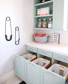 Beautiful turquoise laundry room design with hidden laundry basket storage as hampers. Laundry Basket Storage, Laundry Room Organization, Laundry Room Design, Laundry Hamper Cabinet, Laundry Detergent Storage, Folding Laundry Basket, Laundry Room Baskets, Laundry Craft Rooms, Laundry Room Art