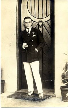 Rudolph Valentino standing in one of the doorways at Falcon Lair
