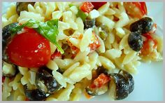 Greek Orzo....may try this with grilled chicken and cheesy garlic bread...yum