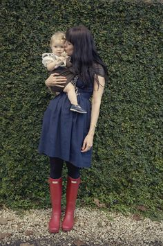 Super love. Vintage clothes, red boots, and baby in a sling. <3