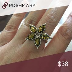 NWOT Sterling Amber Flower Ring Gorgeous and unique. Sterling silver and genuine amber. Never worn. Does not fit me. Size 8.5 Jewelry Rings