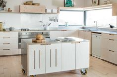 Kitchen island on wheels for the stylish modern home [Design: Sustainable Kitchens]