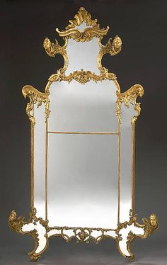 Italian 18th Century Venetian Palazzo Gildwood Carved Figural Mirror, the main arched marginal plates within reeded borders and surmounted by mirrored cresting headed by foliage and scrolls decorated overall with busts and masks within foliate and C-scroll rocaille borders and raised on outswept feet. Circa: Venice, 1790 .