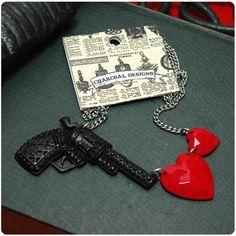 www.brokencherry.com #jewelry #guns #charcoaldesigns  Love Is A Battlefield - Gun Shooting Hearts Necklace   $15.00