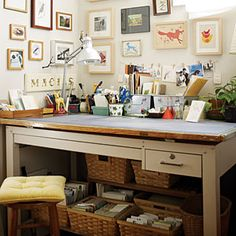 There are several baskets below this home office desk (plus some small boxes and bins above), but the work surface stays clear.