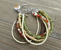 Green, orange, yellow, cream, burnt red. Gemstone, glass and silver metal…