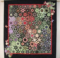 This One Block Wonder quilt has added appliques made from the motifs of the original fabric.
