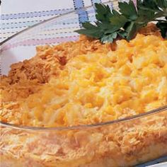 Double Cheddar Hash Browns Recipe -This comforting side dish from Renee Hatfield of Doylestown, Ohio starts with convenient frozen hash browns and canned soups. Shredded cheese and crunchy cornflake crumbs are the fast finishing touch to this potato bake.