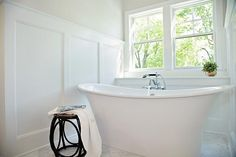 Spa like bathroom features a nook clad in board and batten trim filled with a freestanding tub and hand held tub filler atop a marble diamond pattern floor. Cheap Bathroom Remodel, Bathtub Remodel, Master Bath Remodel, Cheap Bathrooms, Spa Like Bathroom, Downstairs Bathroom, Master Bathroom, Bathroom Ideas, Tub Paint