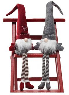 """The gnomes have come to town ready to accent your Christmas decor. These can sit on any shelf or nestle in a little space to add some whimsy. Available in grey/white or red/grey/white. Measures 26""""."""