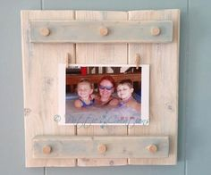 Here is a frame that I made. I got the idea from a book called DIY Wood Pallet Projects. I didn't use a wood pallet like the book does. I purchased some firing wood from Lowes. This frame is great because you can change the photos often. There are 2 tiny clothes pins that I bought at a craft store to hold the photo in place.