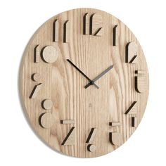 The Shadow Wall Clock by Umbra offers a unique way to tell time in your home. Made of Paulownia wood, the sides of the numbers are painted black which mak...