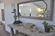 Really like this simple table and the coordinating mirror.  I think that Nate could make this...