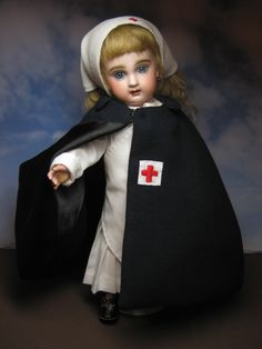 My antique Premiere Bleuette in the Ambulance Nurse uniform.  Juliette is my first Bleuette Premiere.
