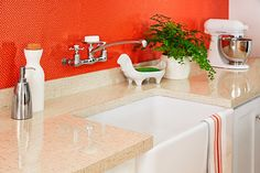 this year's hottest kitchen and bath products: New Looks in Laminate. Formica gets fresh, updated retro style, along with a glossy new scratch-resistant finish, with the Jonathan Adler Collection. Choices include neutral Lacquered Linen (countertop) and zesty orange Greek Key (backsplash). Sheets, from about $17 per square foot;  via @formicagroup