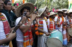 Pohela Baishakh celebration - singing and playing music in disguise of farmers' outfit- Dhaka...