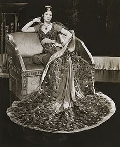 Hedy Lamar in a peacock dress