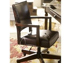 Manchester Swivel Desk Chair  I have a great antique swivel chair, but this looks cool