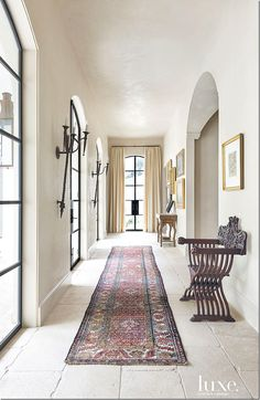 Rough limestone floors, white walls, arches and high ceilings give the main hall way a decidedly Moroccan feel.