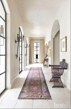 Warm white plaster, limestone floors, steel doors and windows. Kurt Aichen as seen on Cote de Texas blogspot.