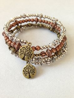 Mixed metals memory wire bracelet with tree of life charms on Etsy, $16.00