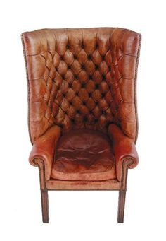 Edwardian leather upholstered porters chair - its almost as though someone is sitting there...